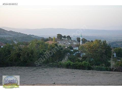 7.200 m2 köye bitişik arsa vasfında tarla.